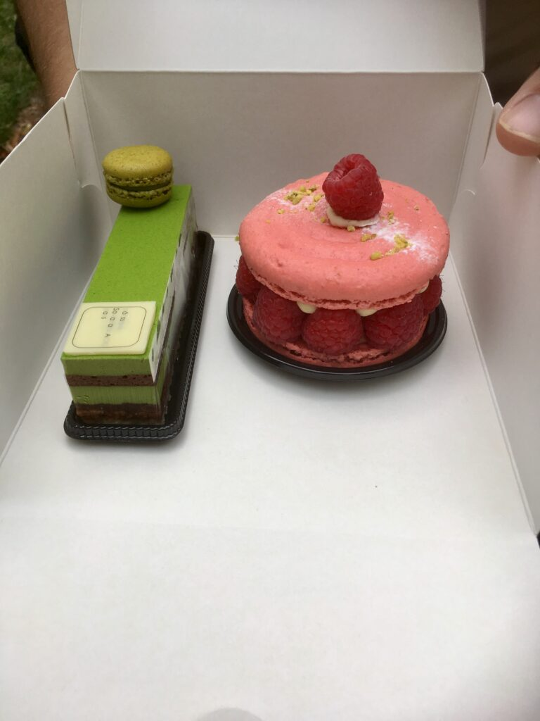 A macaron cake and a Matche cake from Adoroku AORI, in a white open box