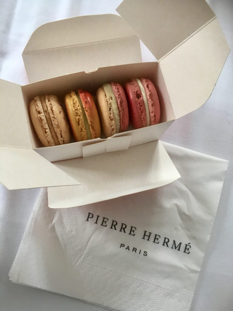 Macarons from Pierre Herme in a white box
