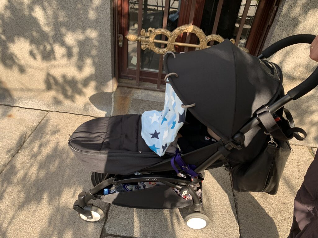 Compact stroller by Phenomenal Globe Travel Blog, stroller, hand that;s pushing it