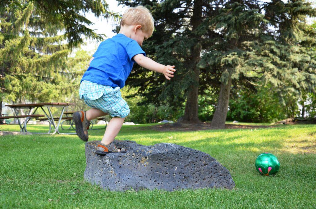His favorite ball, Yuri climbing a small rock and kicking a ball