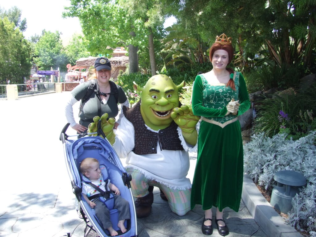 Shrek and Fiona, with Cosette and Yuri in the stroller on a picture at Universal