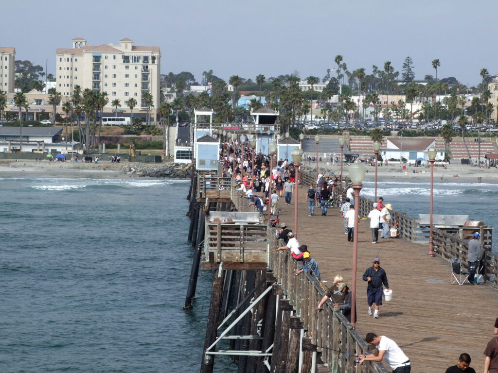 Oceanside Pier full with people, lots of people fishing, along the California road trip