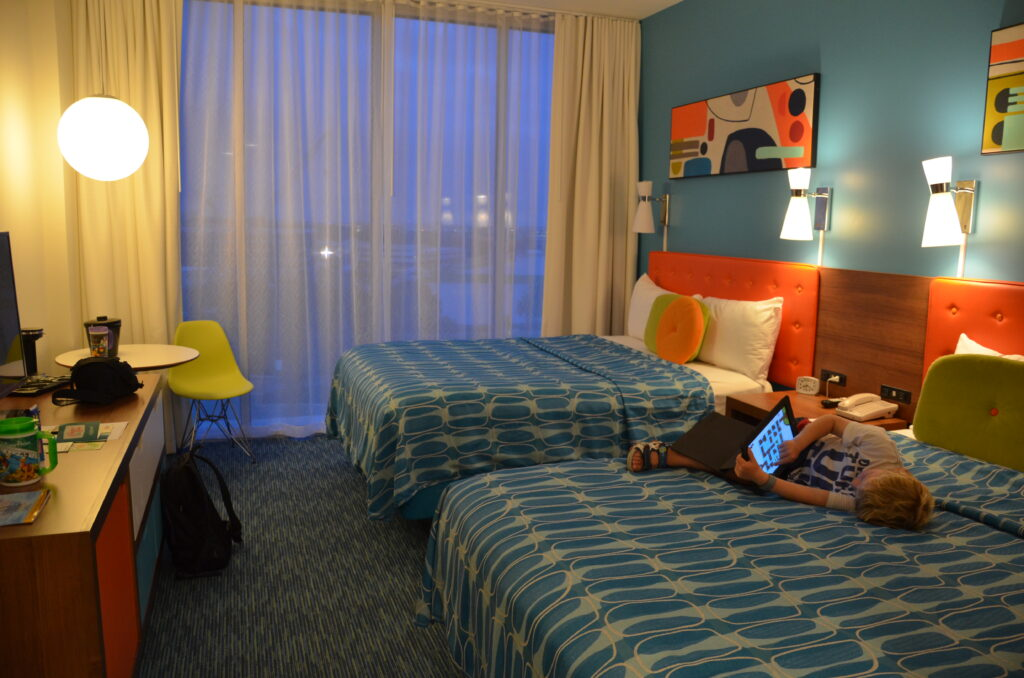 Our room at Cabana Bay Beach Resort, colorful and with 2 Queen beads. Yuri is liying on the right one