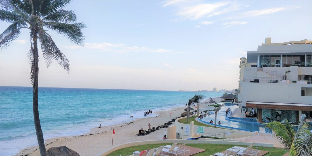 Cancun by Venaugh, the ocean with a part of th beach and hotels on the beach