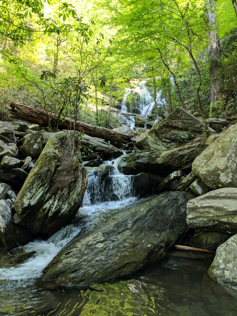Catawba Falls by Explore More Clean Less, cascading down several tiers in a forest among rocks