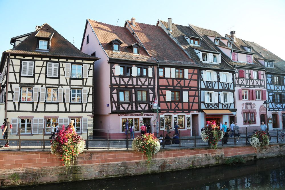 Colmar by France Bucket List, colorful houses, craft houses, at a street with a river in front