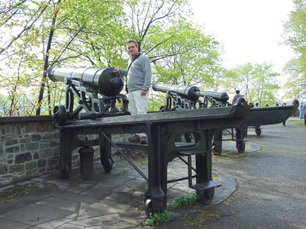 Canons at Quebec City, several in a row, Paul behind the first one