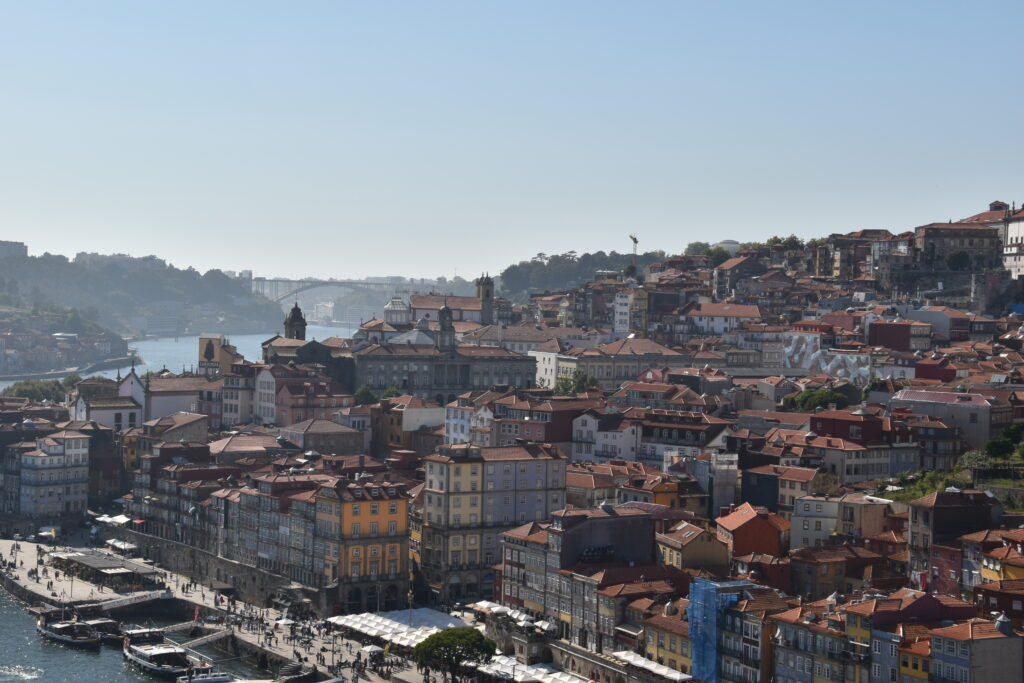 Porto as seen from the Luis I bridge, an overview of the colorful houses sprawling uphill, with the river at the bottom and around the corner
