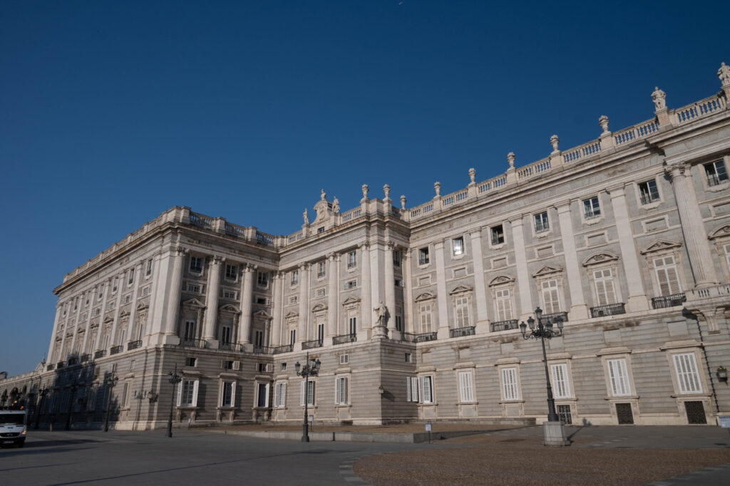 Madrid by Guide Your Travel, a white castle/estate with a clear blue sky above it