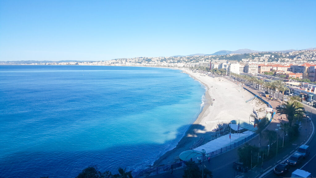 Nice by The Unknown Enthusiast, the beach with the sea on the left, on the right next to the beach the city