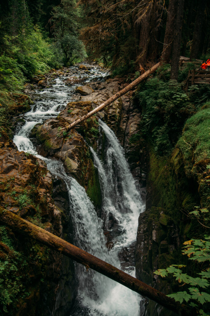Sol Duc Falls by Have Clothes, Will Travel, first on the left above a river cascading down and then several plunges down the cliff