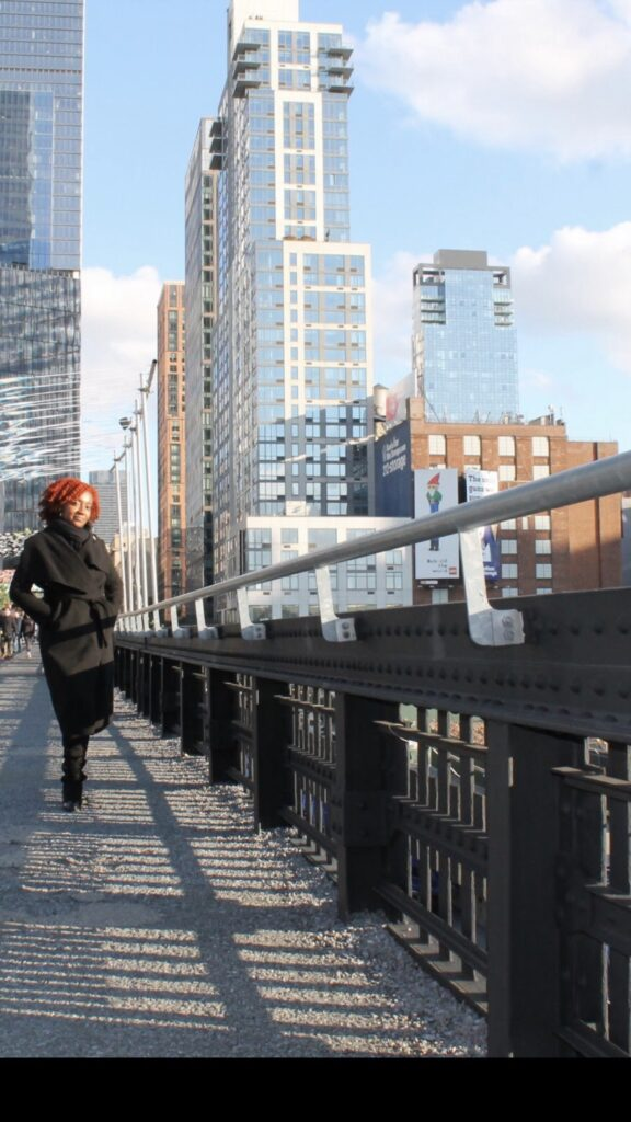 The Highline at NYC by The Nitty Gritty Travel OT, on the left Lenore is standing, behind are high rise buildings