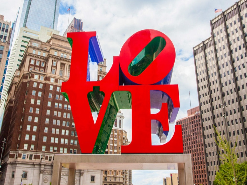 The city of brotherly love San Francisco by Leisurely Drives, the LOVE sign in red, with behind it high rise buildings