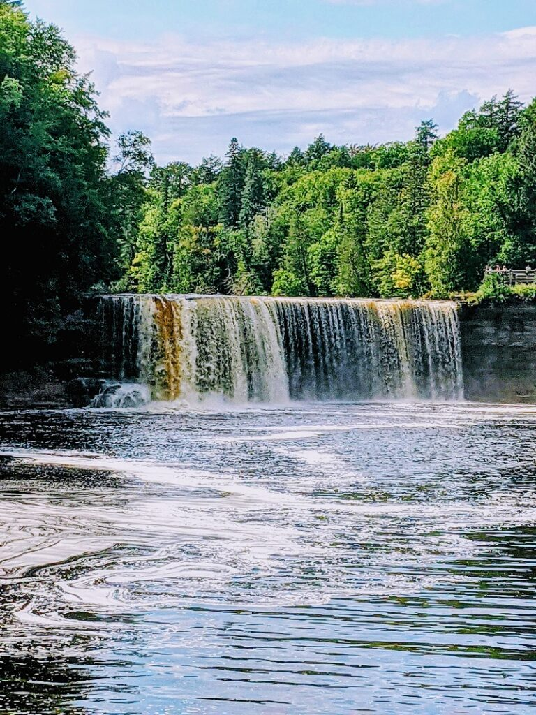 Upper Tahquamenon Falls by Veggies Abroad, a waterfall in the back coming over a small cliff