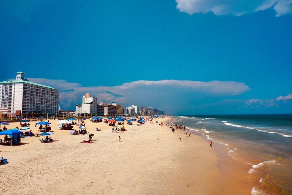 Virginia Beach Oceanfront by Wander With Alex, most of the picture is beach, with ocean at the right and hotels on the left
