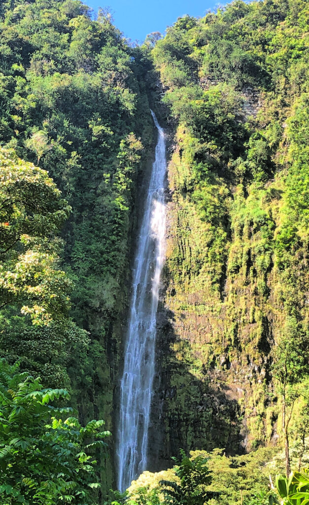 Waimoku Falls by Our Woven Journey, a waterfall that plunges down a single drop, from high